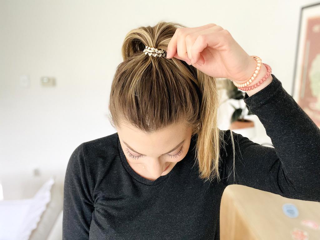 putting teleties hair tie in hair