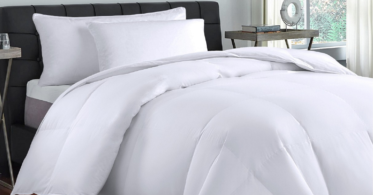 bed with white bedding in bedroom