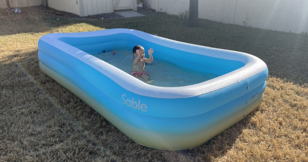 baby in sable inflatable pool