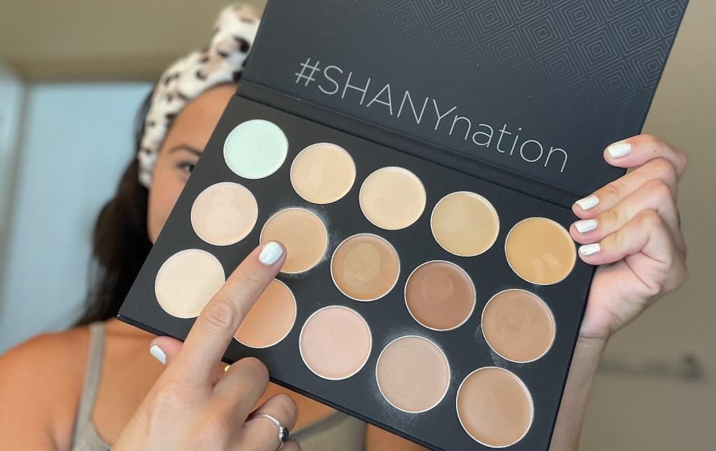 woman holding up neutral makeup palette