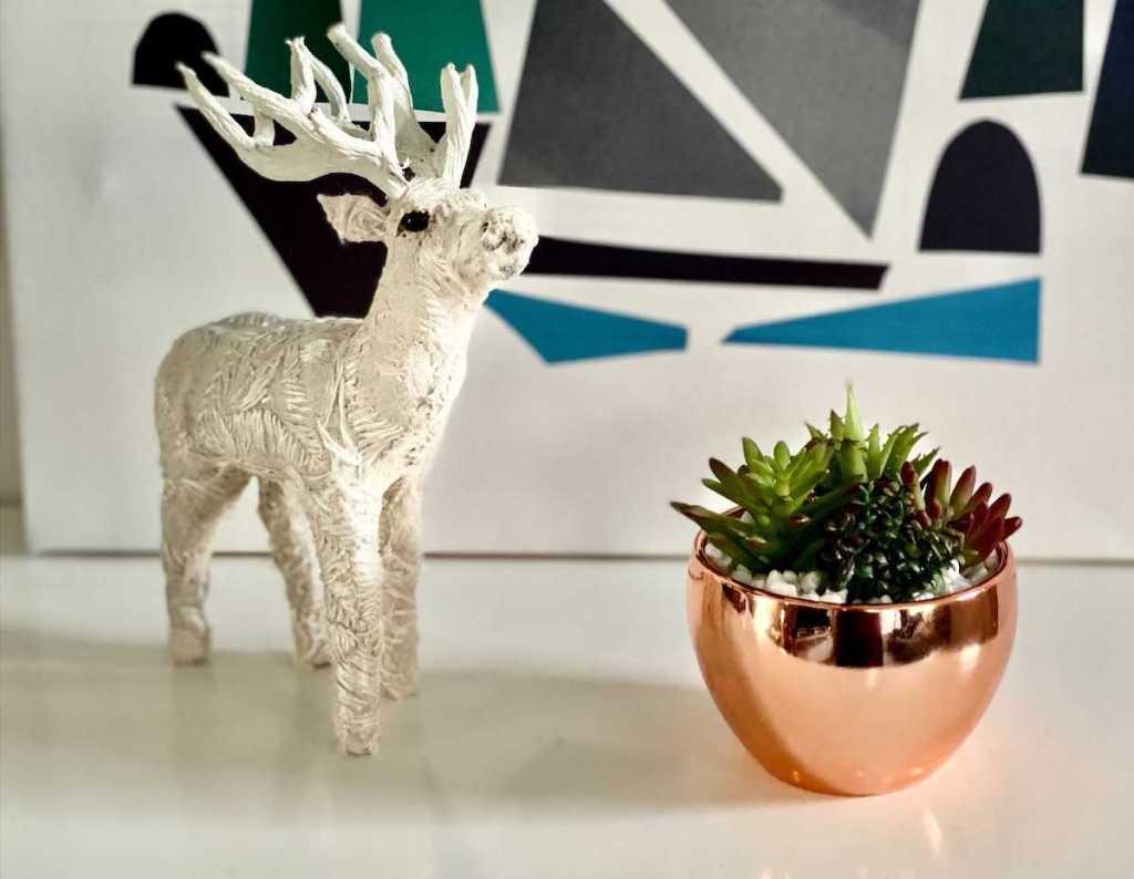 small reindeer and bronze planter sitting on table - wayfair way day furniture sales