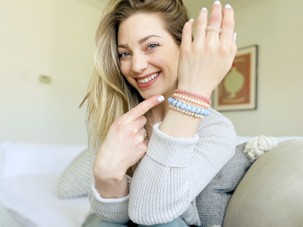 woman holding up hand with teleties on wrist