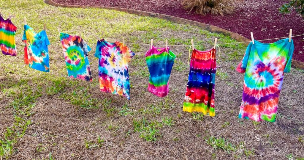 tie dye shirts on a line