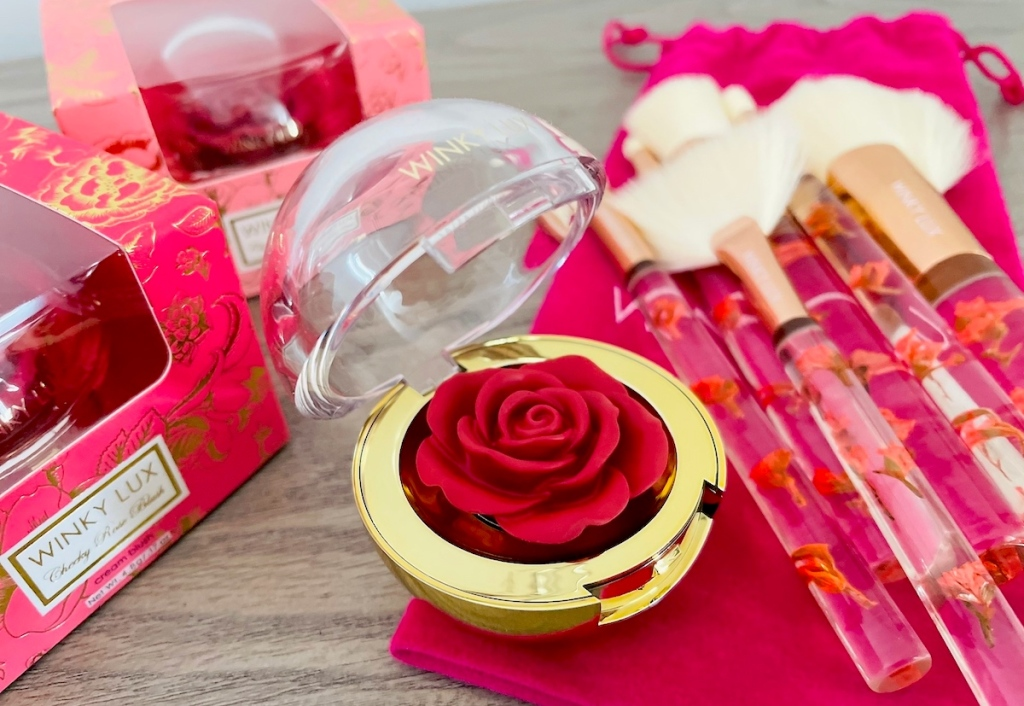 close up of winky lux rose blush makeup and brushes