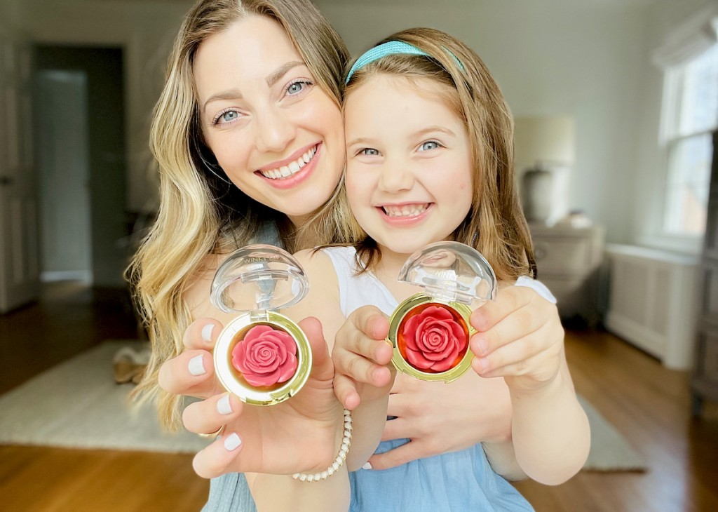 woman and girl holding rose shaped blush makeup