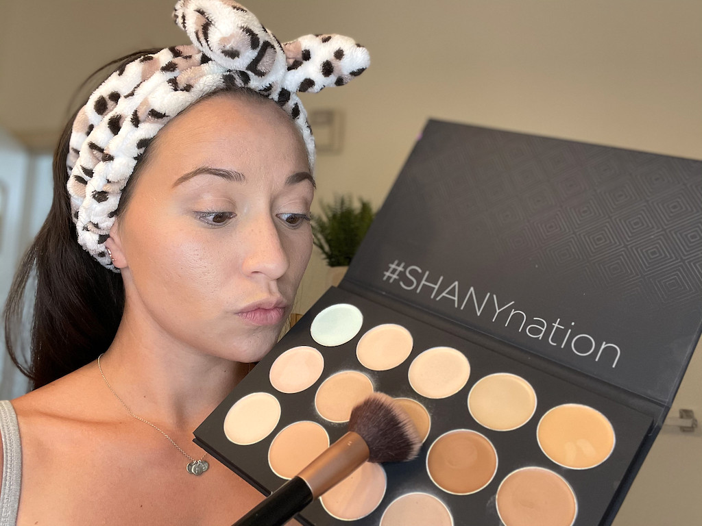 woman holding large cosmetics palette