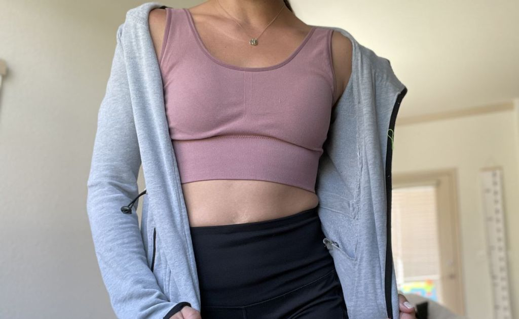 woman wearing a sports bra and jacket