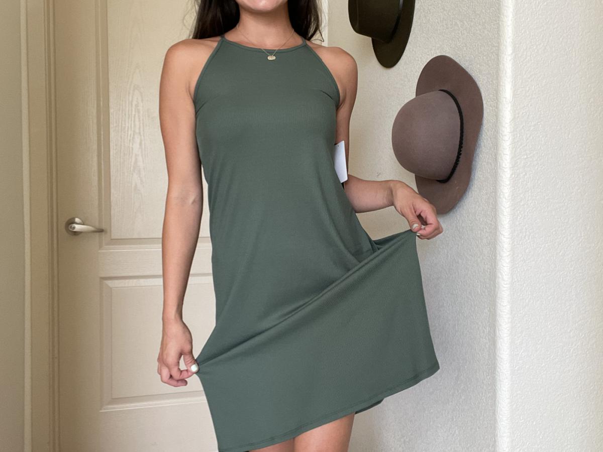 woman wearing a sleeveless green 32 degrees dress
