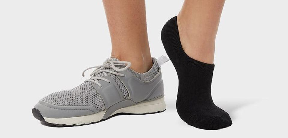 person wearing a shoe and a sock