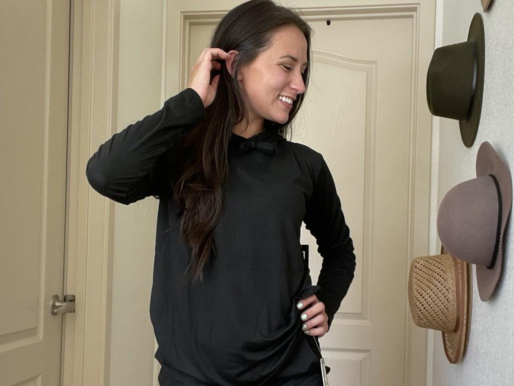 woman wearing black hooded 32 degrees sweatshirt