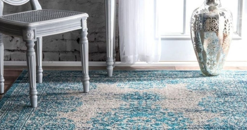5x7 Area Rug with chair, vase and end table