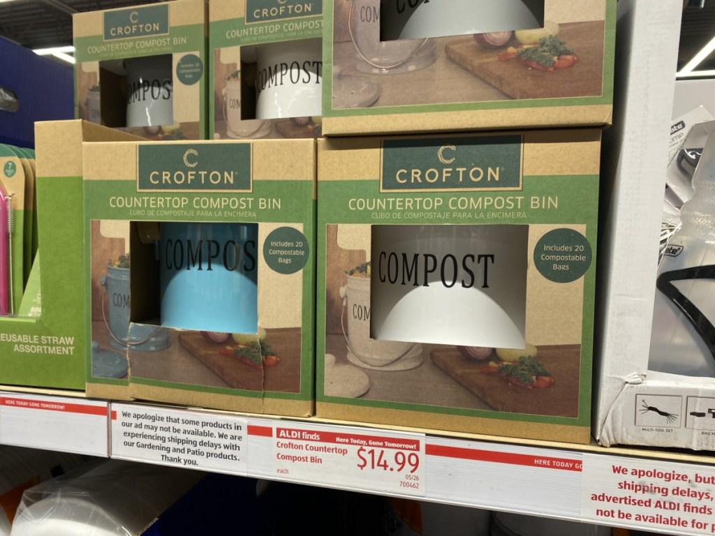 in-store display of compost bins in packaging