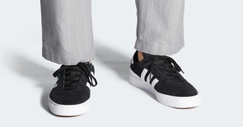 man wearing adidas Busenitz Vulc II Shoes