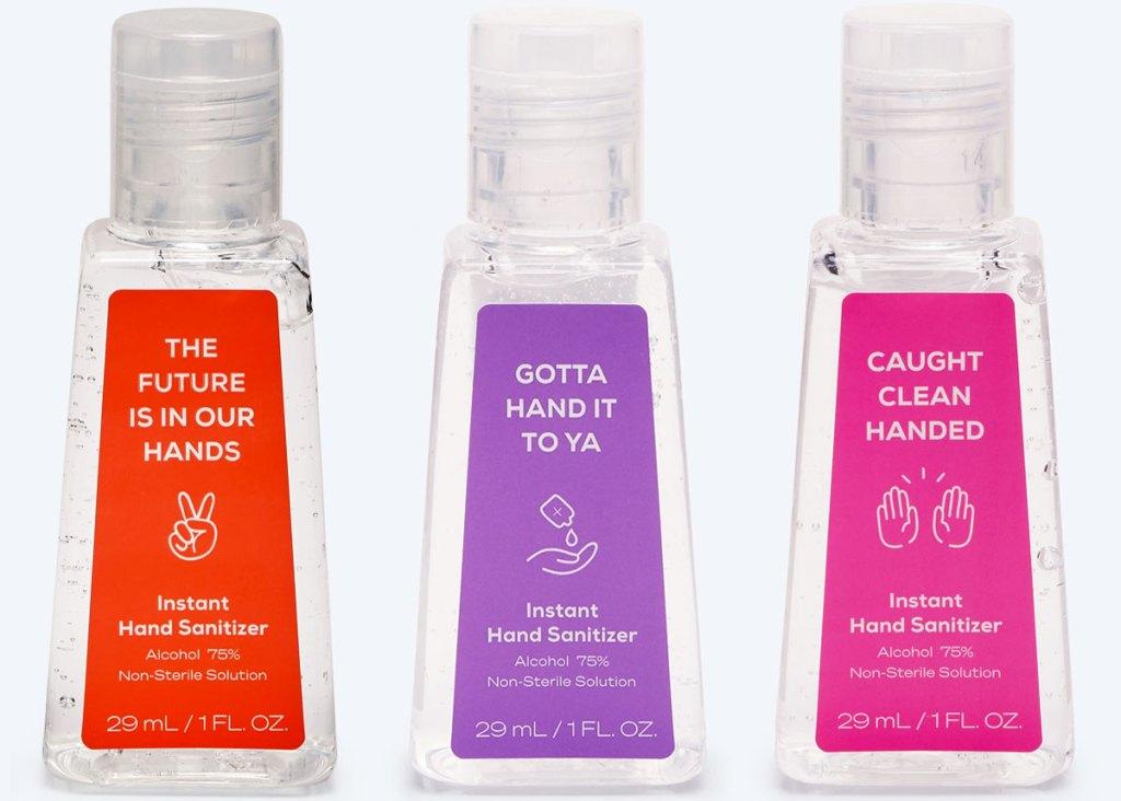 three small bottles of hand sanitizer