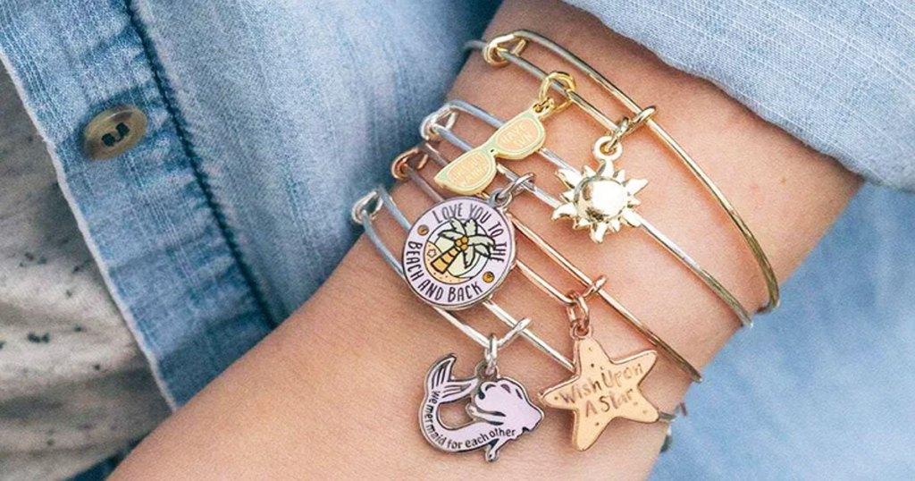 womans arm with multiple bangle bracelets