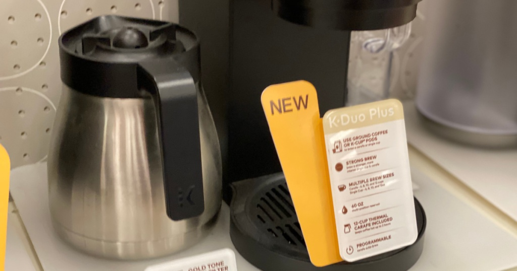 coffee maker and silver carafe on shelf