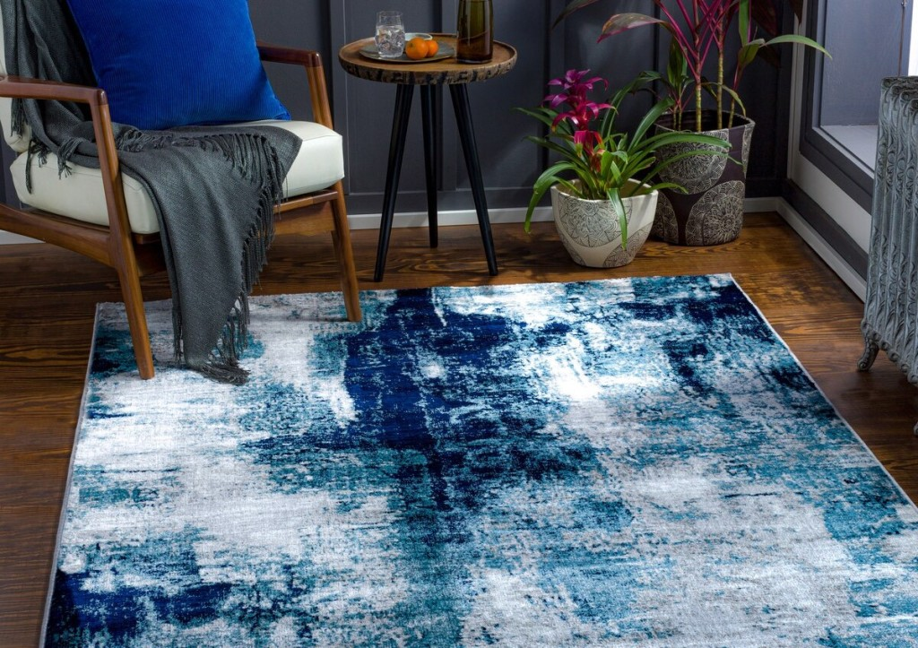 area rug by a chair and table