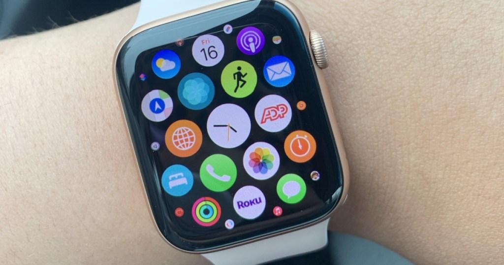 white band smart watch on wrist