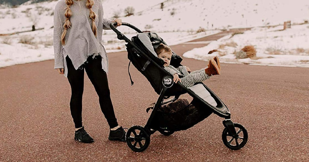 Woman pushing a Baby Jogger City Mini GT2 Stroller on the beach