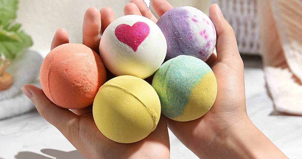 hands holding a variety of bath bombs