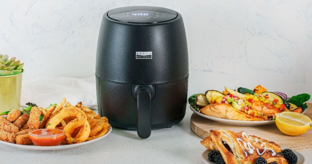 air fryer with food around it