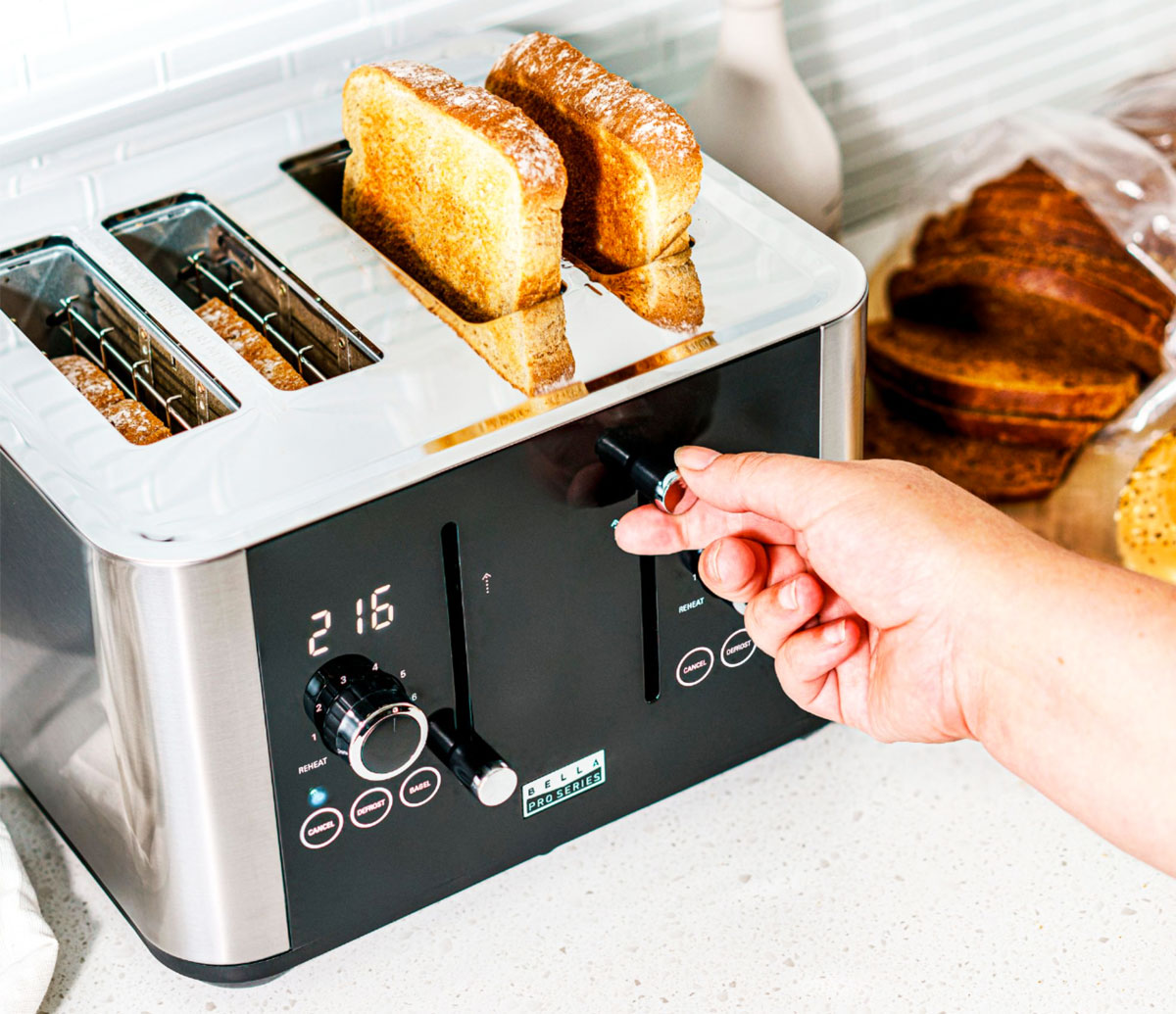 person grabbing toast from toaster