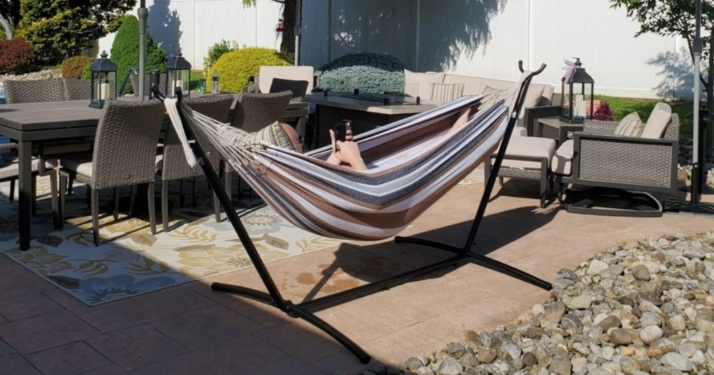 Man laying in Best Choice Products Hammock with metal stand