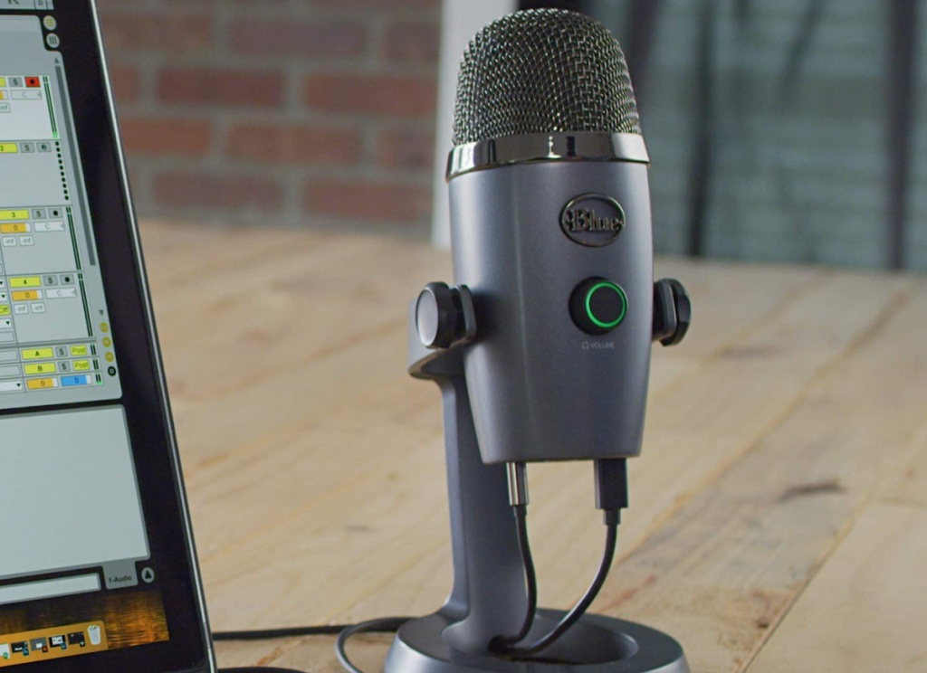 Blue Yeti Microphone next to a computer