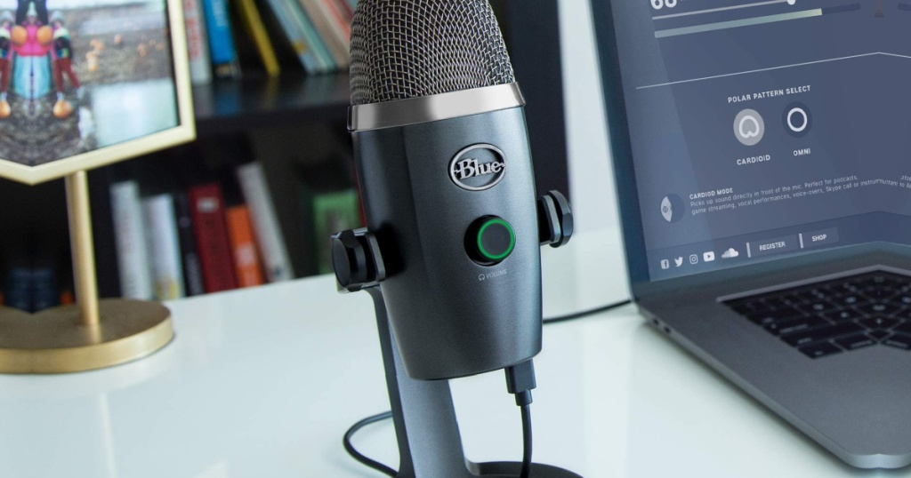 Blue Yeti Microphone in Shadow Grey next to a laptop