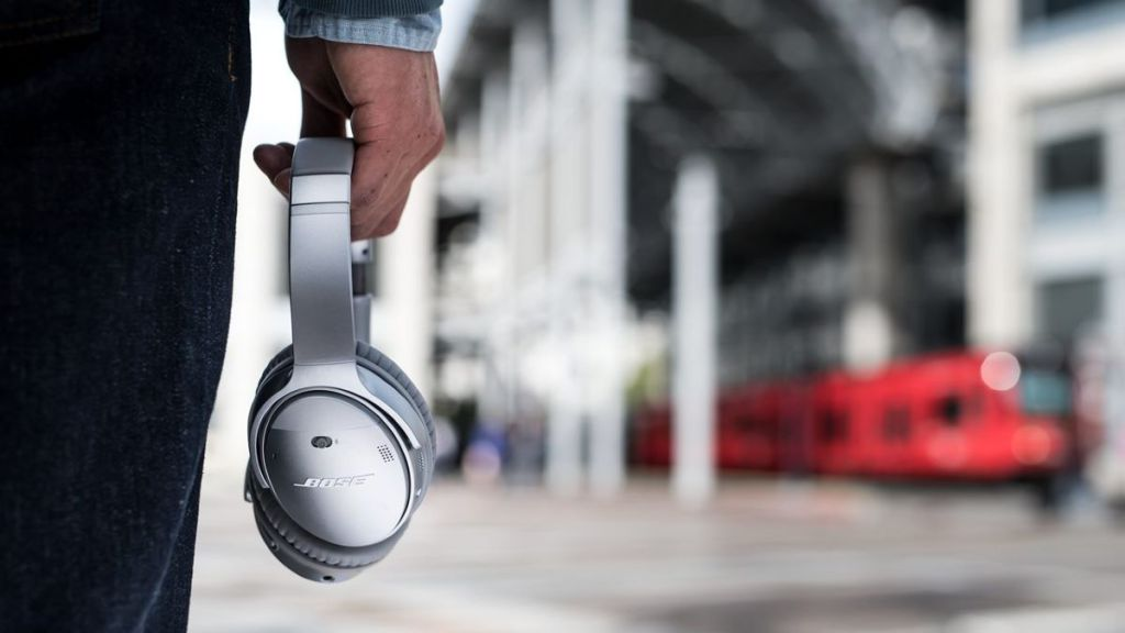 hand holding a pair of headphones