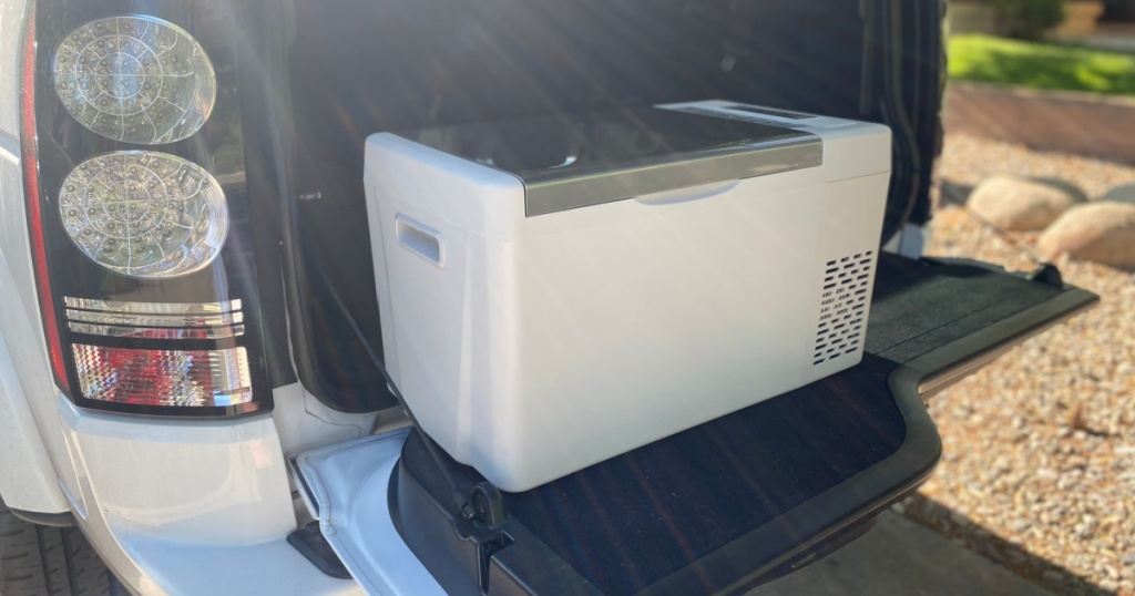 Truck trunk open with portable cooler inside
