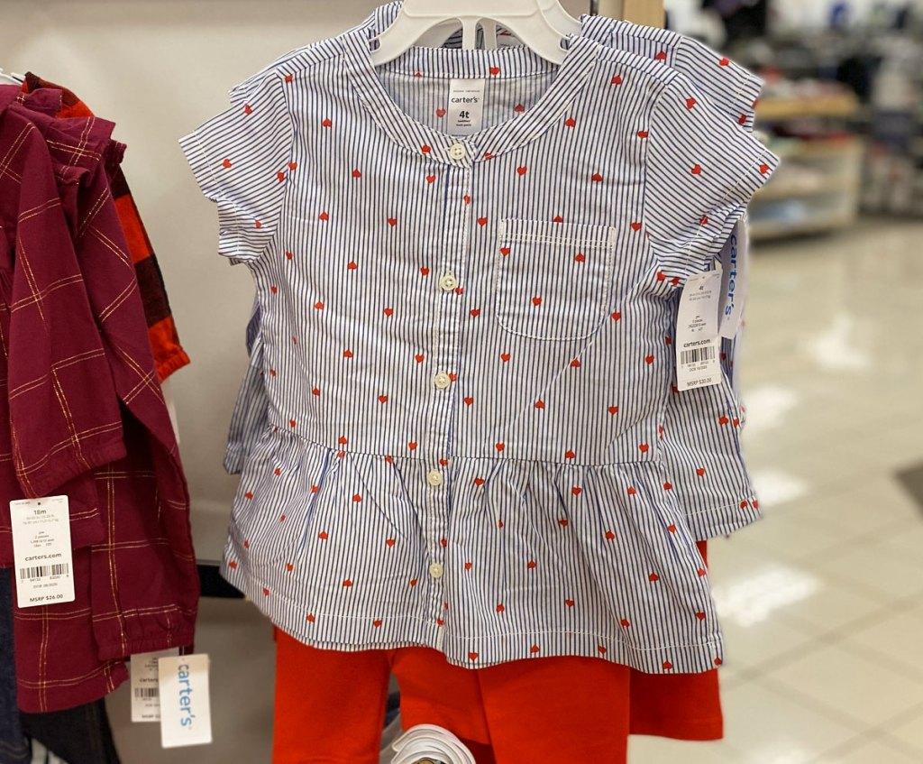 carter's girl 2-piece set on hanger in store