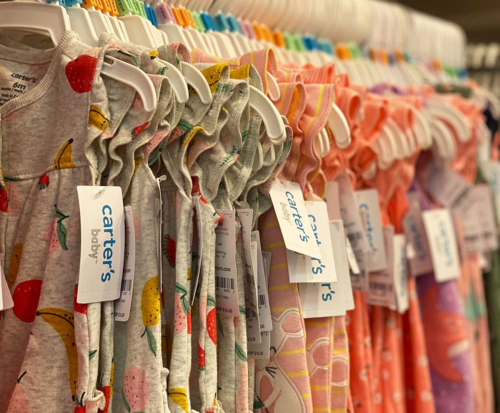 rack of carter's baby dresses