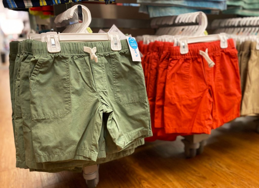 carters boys shorts on hangers in store