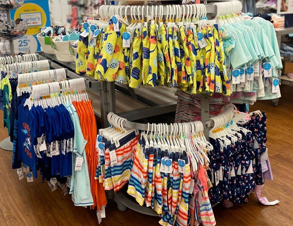 rack of carter's boys swimwear in store