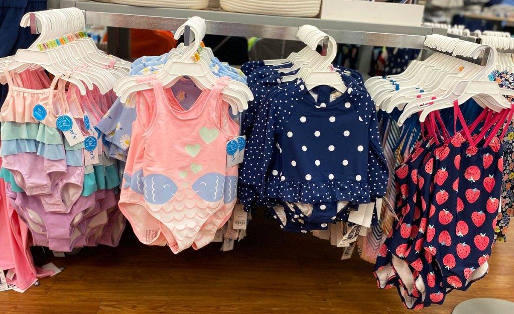 girls swimwear on hangers in store