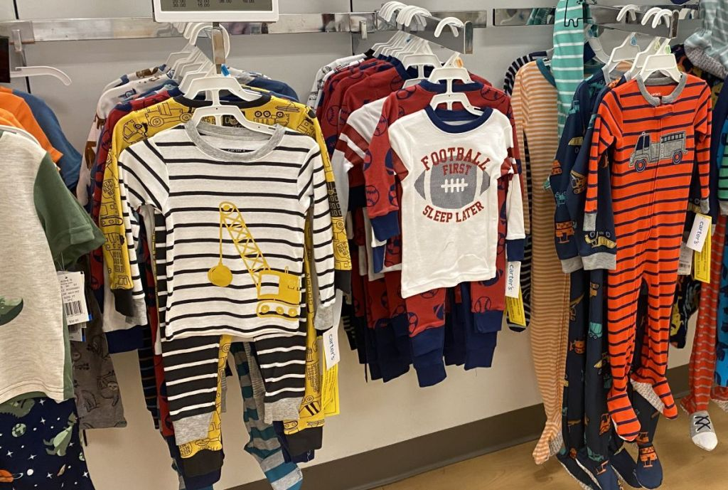 Carter's Pajama Sets on hangers at a store