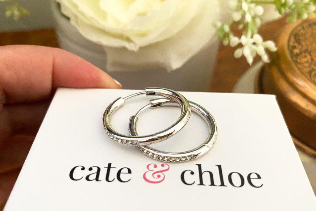 pair of hoop earrings on a white cate & chloe box