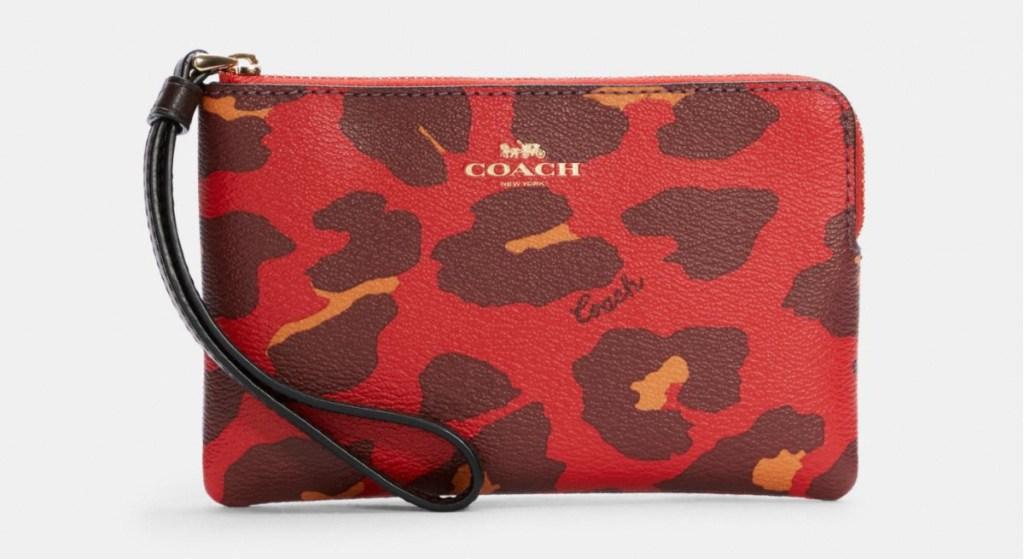coach brand wristlet in red leopard print