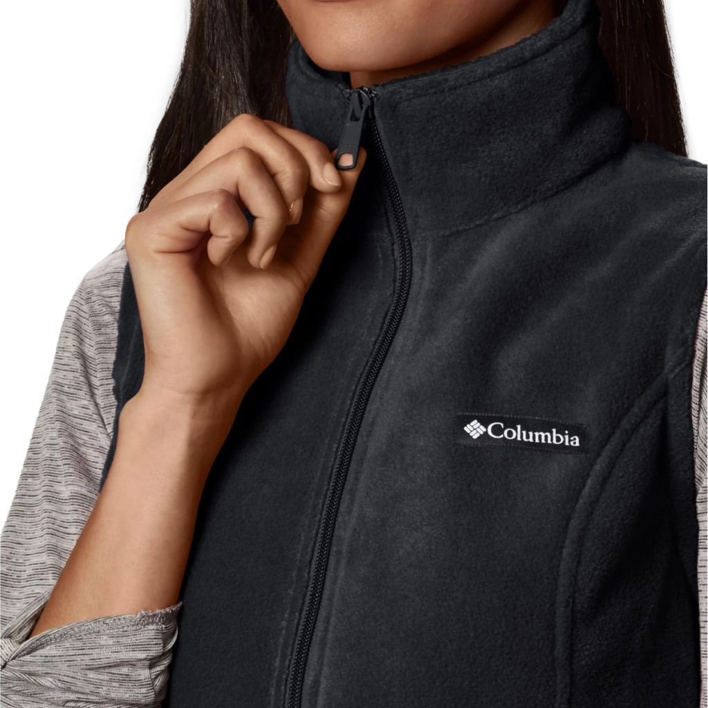 woman zipping up a plush vest