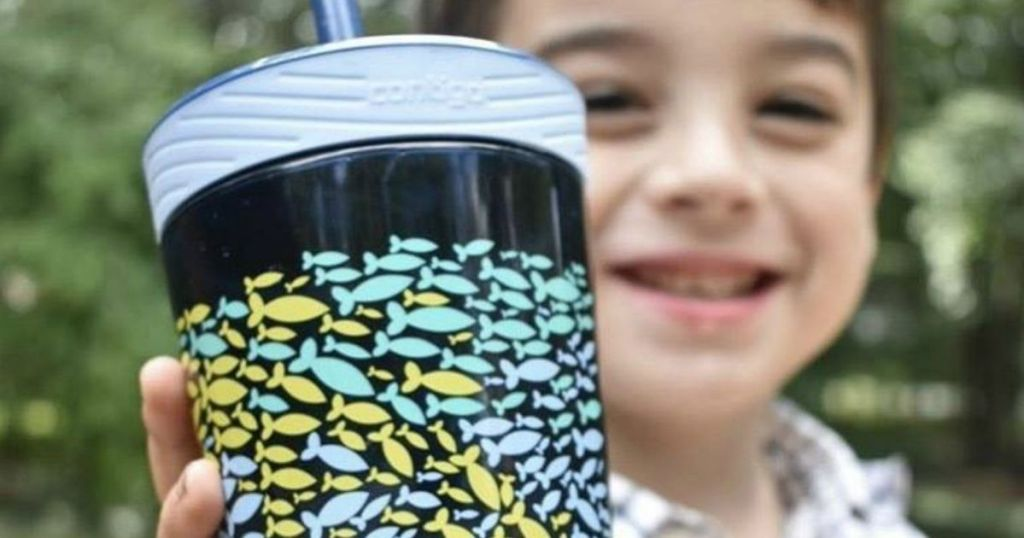 boy holding a tumbler with fish on it