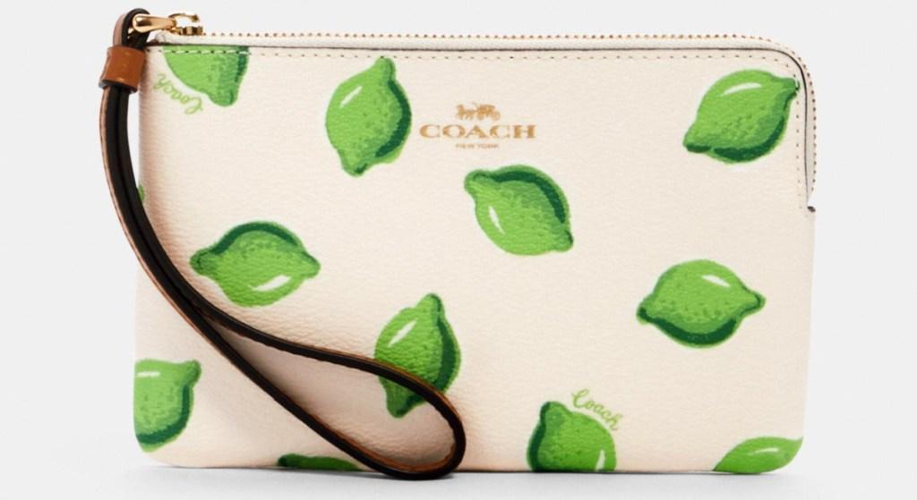 lime printed wristlet Coach brand