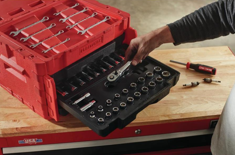 hand grabbing a tool out of a box
