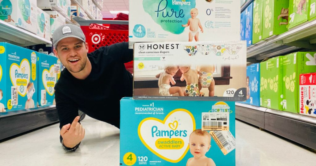 man on floor besides diapers boxes