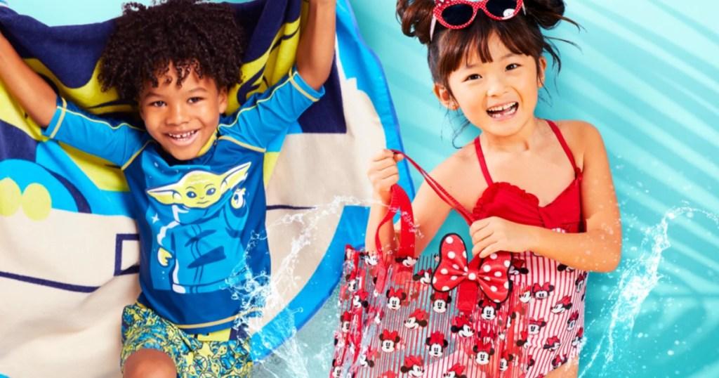 two kiddos wearing disney swimsuits