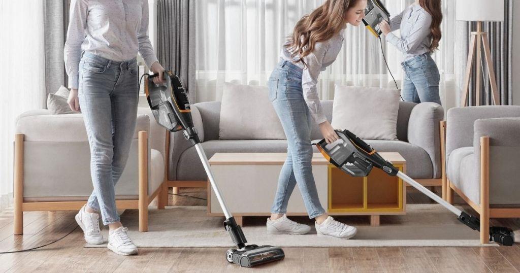 three women vacuuming