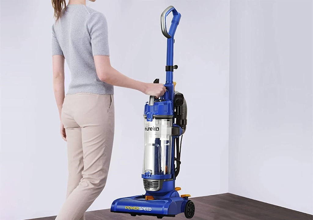woman carrying a vacuum
