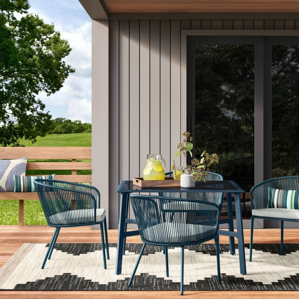 Fisher Patio Chairs at blue table