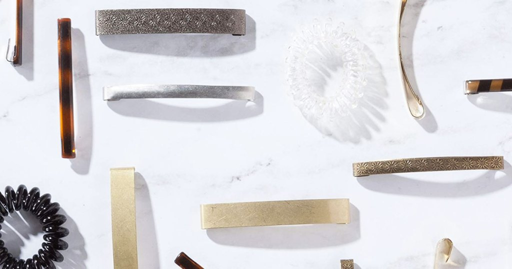 hair clips and ties on a marble counter
