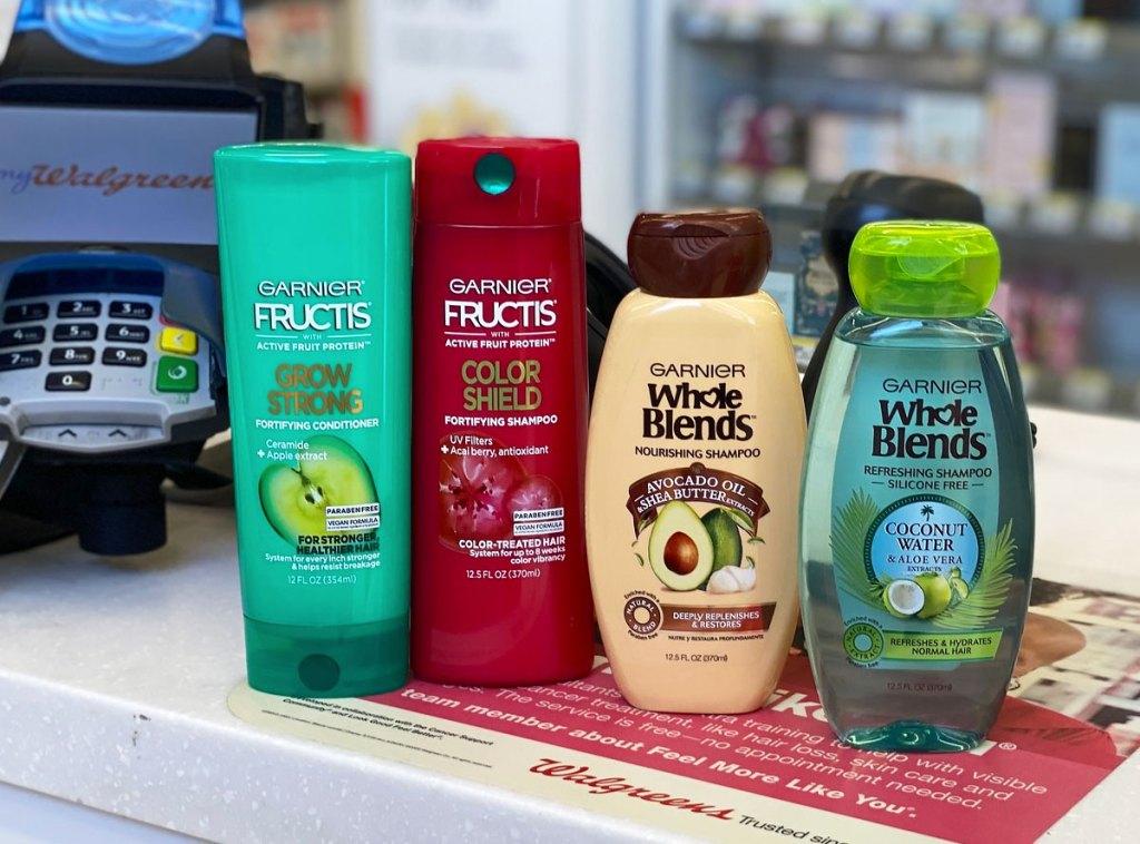 garnier shampoo and conditioner bottles on counter at walgreens